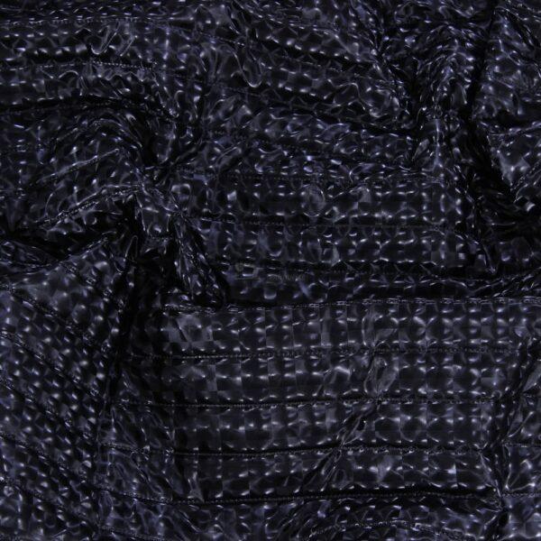 juodas 3D rasto stapuotas striukinis audinys