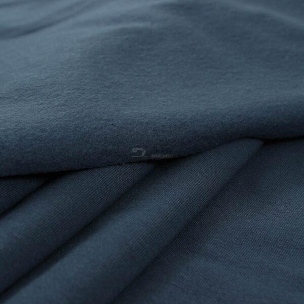 dzinso spalvos trikotazas su pukeliu