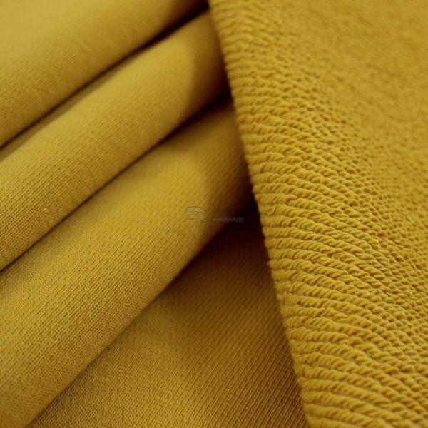 garstyciu spalvos trisiulis kilpinis trikotazas