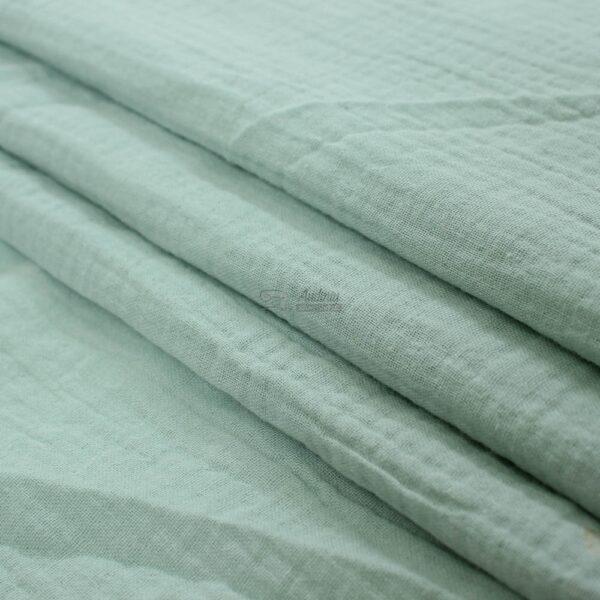 mėtines spalvos muslinas