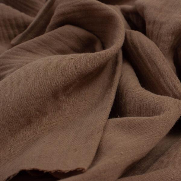 kakavos spalvos muslinas